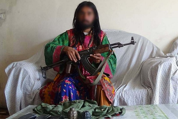 Taliban commander arrested wearing women's clothing in eastern Paktika province. Photo: NDS