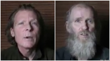 FILE - Timothy Weeks of Australia, left, and American Kevin King (photo taken from video sent to VOA from Taliban)