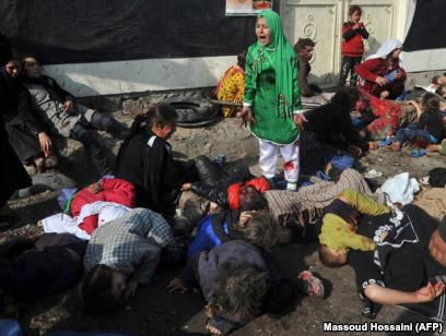 FILE -- Tarana Akbari, 12, screams in fear moments after a suicide bomber detonated a bomb in a crowd at the Abul Fazel Shrine in Kabul, Dec. 06, 2011. Photographer Massoud Hossaini won a Pulitzer Award for this photo in 2012.