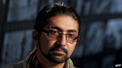 FILE - Massoud Hossaini sits for an interview following a discussion of his Pulitzer Prize-winning photograph at the Newseum in Washington, May 24, 2012. Hossaini, who has been working for the Associated Press in Kabul, said he survived what he called an assassination attempt in Kabul on March 29, 2018.