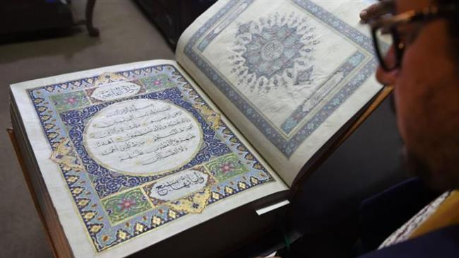 Afghan master miniature artist Mohammad Tamim Sahibzada shows a Quran made with silk fabric at the Turquoise Mountain Foundation in Mourad Khani, Kabul on April 19, 2018. (Photo by AFP)