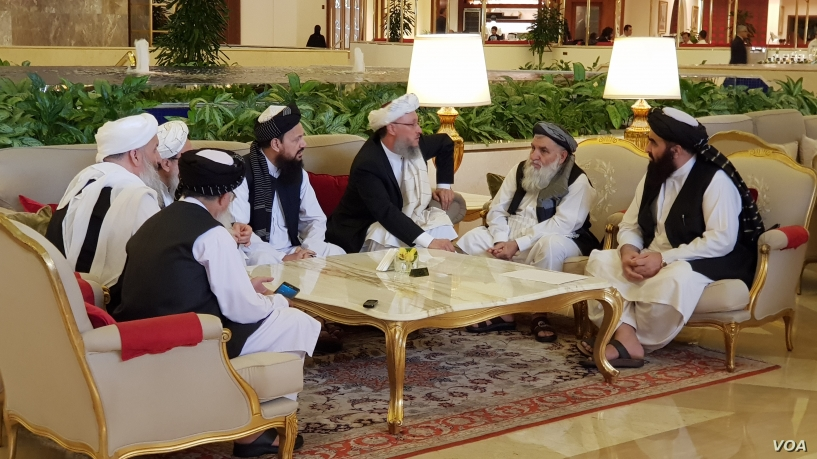 Members of the Taliban delegation are seen at the Sheraton Doha, before the start of the intra-Afghan dialogue, in Doha, Qatar, July 7, 2019.